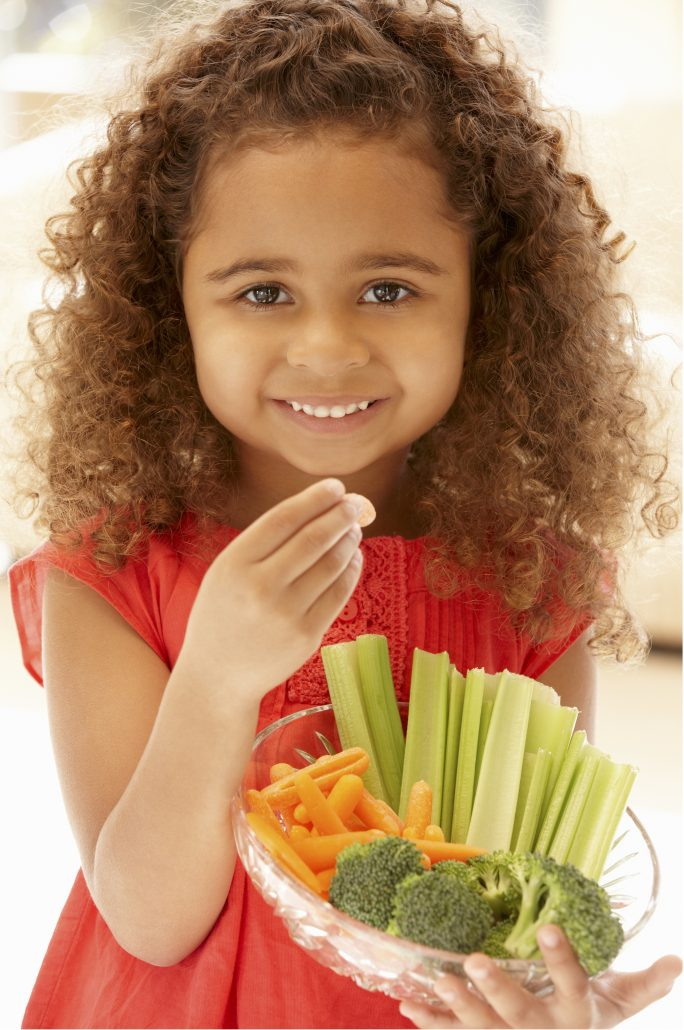 girl eating veggies to help with allergic asthma
